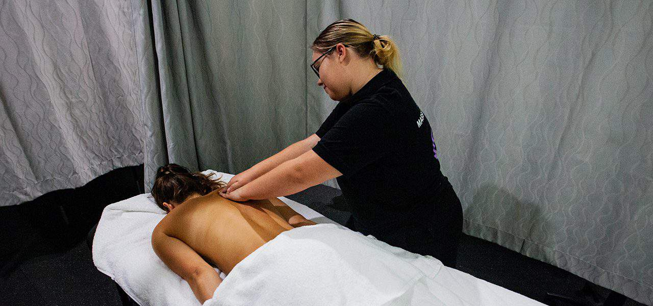 Lady massaging person