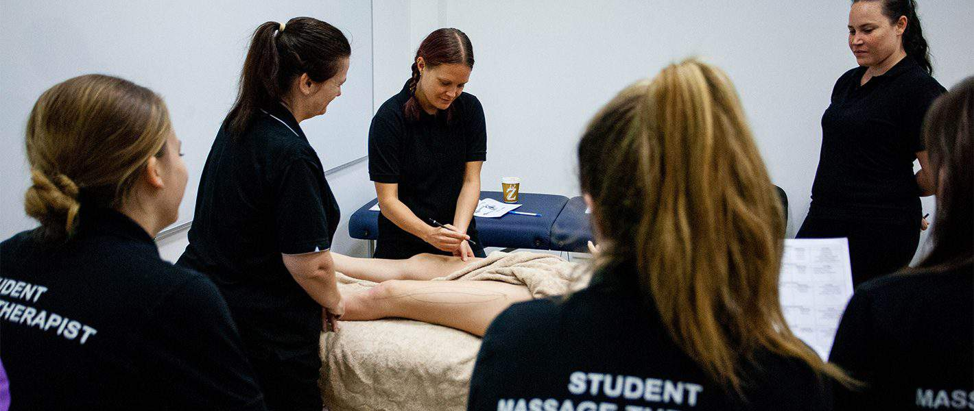 students learning massage at Q Academy Gold Coast