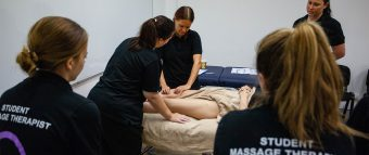 second photo of students learning massage at Q Academy Gold Coast